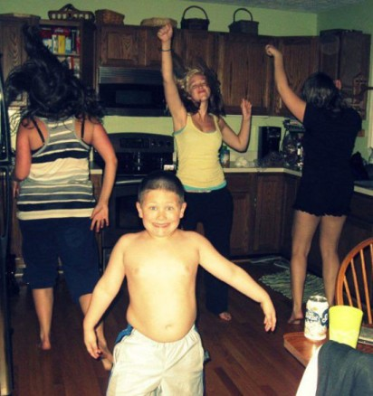 girls-dancing-kitchen-young-shirtless-chubby-boy-smiling-camera1